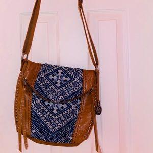 The sak brown and blue bag